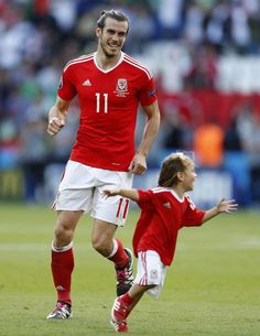 Gareth Bale celebrates with his daughter after the game.
