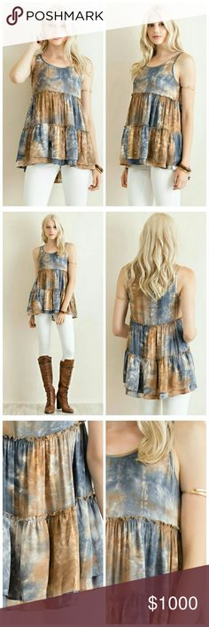 Tie-dye Top Tie-dye printed scoop neck empire top with 1-inch sleeves, tiered layers, and reversed stitch throughout.  Non-sheer. Unlined. Woven. Lightweight.  Fabric: 100% Rayon Tops Tank Tops