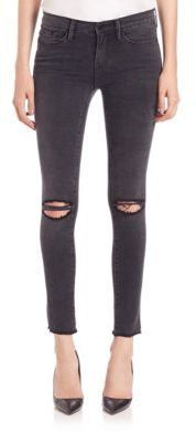 Black skinny jeans with knee holes. Great paired with sneakers or heels. FRAME Distressed Skinny Jeans
