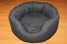 Handmade bed for cats/small size dogs,manually sewn and finished,made from natural materials, diameter 48 cm, depth 23 cm,filled with wadding and comfortable for any furry pets.Removable cushion.Unique design! The round shape of the bed and high margins are ideal for squatting and provides a sense of security for the pet . The bed is washable at 30 ° C .