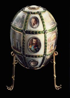 Russian decorative egg made to commemorate the Coronation of  Nicholas  the second. Emperor of all the Russias.  Also shows members of the Romanov family.
