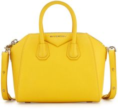 "GIVENCHY ANTIGONA MINI LEATHER SATCHEL BAG, YELLOW  $1,750 by Givenchy at Neiman Marcus          Available Colors: YELLOW Available Sizes: DETAILS Givenchy ""Sugar"" grained goatskin satchel. Palladium hardware and tonal topstitching. Rolled tote handles; 3"" drop. Adjustable crossbody/shoulder strap; 17"" drop. Extended zip top. Envelope flap detail with metal Givenchy logo lettering. Inside, cotton lining and pocket. 7""H x 11""W x 5""D. Made in Italy."