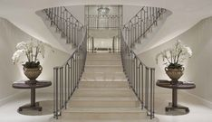 Grand staircase branches into two with metal handrails | Sophie Paterson