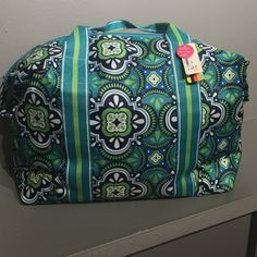 Travel Tote Beautiful, colorful travel tote.  Perfect size for carry-on!  24 x 16 x 7.75.  100% polyester. All For Color Bags Totes