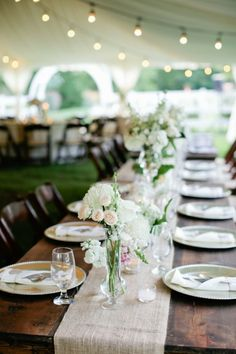 Burlap Table Runners | See the tented Cedarwood wedding on SMP - http://www.stylemepretty.com/little-black-book-blog/2014/01/02/rustic-tented-historic-cedarwood-wedding/ Kristyn Hogan Photography