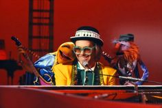 "Sam the Eagle is appalled by guest star Elton John, who he says ""dresses like a stolen car."" When Kermit tells him that musicians as celebrated as Mozart have always dressed extravagantly, Sam confidently bets that it is untrue. Unfortunately for Sam, he is proven wrong and is forced to introduce the closing number wearing an outfit that rivals Elton's for its flashiness. Scooter, on the other hand, appears to be Elton's biggest fan, introducing him as ""the greatest talent in the history…"