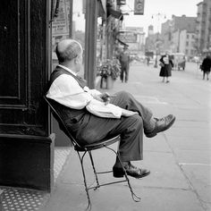 New York, man on a chair - by Vivian Maier