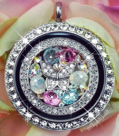 This is so pretty! Love the butterfly in the middle! #Butterfly #OrigamiOwl #Sparkles #ColorfulJewelry #CustomJewelry