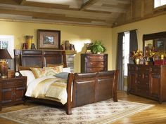 Vintage Rustic Bedroom Ideas with Natural Shade: Rustic Bedroom Ideas Flowery Motive Carpet Dark Wooden Color Bed Frame Cream Wall Wooden Ceiling Grey Curtain Indoor Plant ~ dickoatts.com Bedroom Designs Inspiration