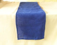 """Burlap Table Runner 14 Inches X 90 Inches - Blue by ArtOFabric. $9.99. This table runner is a long, narrow piece made of 100% jute burlap that measures 14"""" X 90"""" and it is made to be placed lengthwise or horizontally on the table.The Burlap tablecloth's simplicity and utility make it a year round favorite"""