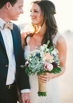 Creative industrial wedding   Photos by Emily Blake   100 Layer Cake    orange & cream dahlias, succulents, blue hydrangea, white anemones, erygnium, plumosia, seeded eucalyptus, dusty miller, rosemary