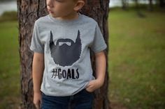 It's never too early to start making some goals. This adorable Beard #Goals shirt is perfect for that little boy who can't wait to be just like his dad. This shirt is expertly handcrafted with high grade vinyl and customized to your choice of three colors.