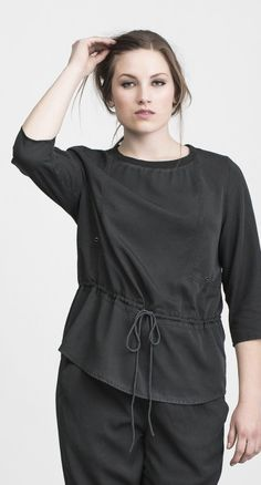 AMORPHA  Military green top with narrowing in life  Amorpha is based on our bestseller ASKELLA and three quarters sleeve army green top  $73 USD