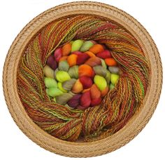 Roving to yarn - the center shows the original roving, which was spun into the surrounding yarn.