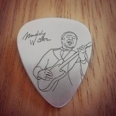 We inspired this silver pick by Muddy Waters (1913 – 1983), the father of modern Chicago blues.  Made of rhodium plated sterling silver 925  Dimensions: 30mm height, 0.6mm thickness  Our designs of the silver picks are based on famous pictures related to music history  Manufacturing process includes treatment by hand and laser engraving.