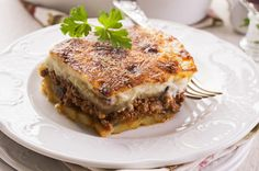 Hearty and tasty dish - Greek moussaka with eggplant and minced meat Bechamel Sauce, Sauce Recipes, Cooking Recipes, Cypriot Food, Macedonian Food, Greek Dishes, Mediterranean Dishes, Suppers, Vegetables