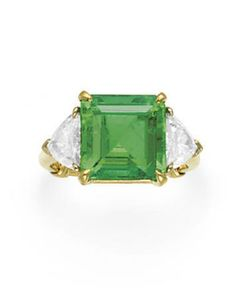 AN EMERALD AND DIAMOND RING, BY VAN CLEEF & ARPELS Set with an square-cut emerald, weighing approximately 5.78 carats, flanked on either side by a trillion-cut diamond, mounted in gold, with maker's mark, in a Van Cleef & Arpels gray suede box Signed V.C.A., for Van Cleef & Arpels, N.Y., no. 4226 S.O. (Special Order)