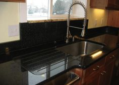 Integrated drain board in granite with runnels runnels for Quartz integrated sink
