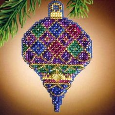 Diamond Holiday - Christmas Jewels Charmed Ornaments 2011 - Mill Hill Beaded Cross Stitch Christmas Ornament Kit with Charm MH161306. Diamond Holiday is one in set of six gorgeous ornaments in the 2011 Mill Hill Charmed Ornament collection! Makes one beaded cross stitch Diamond Holiday Charmed Christmas Ornament featuring a Mill Hill scalloped gold heart. Finished Size: 2 x 3.25 inches (5.1 x 8.3 cm). Design Size: 29 stitches wide x 46 high.
