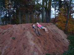 Enjoying the dug out dirt pile before it gets taken away
