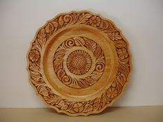 Direct from the artist's studio, hand carved in central European folk art design by J Bayer renown master carver, member of the NWCA of America.  The plate is carefully designed and all hand carved with the use of a single pocket knife.  The size is 12 inches in diameter, finished in antique Maple color and shiny.
