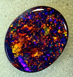 Black Opal from Coocoran Opal Fields, Lightning Ridge, NSW, Australia. GORGEOUS!!!