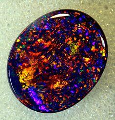 Black Opal from Coocoran Opal Fields, Lightning Ridge, NSW, Australia More