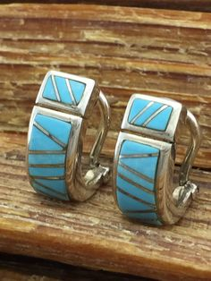 This is a gorgeous pair of vintage, genuine Sleeping Beauty turquoise inlaid pierced half hoop earrings set in solid sterling silver. The design and