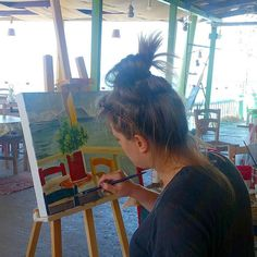 Metaxart  artist painting outdoors.