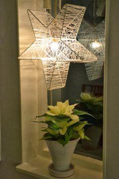 Gör en julstjärna av en gammal lampstomme och lingarn