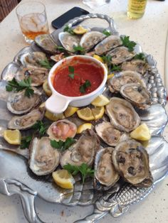 Raw oysters and clams with homemade cocktail sauce