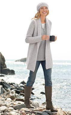 long cardi, henley, skinny jeans, boots, and a beret.