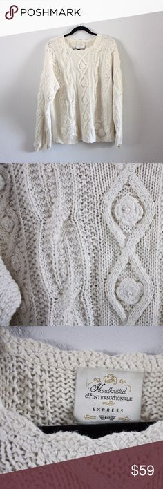 Express Handknitted Internationale Pearl Sweater This gorgeous intricately hand-knit creamy white sweater is a must-have! Has pearls knit into it!! Looks stunning with all heart colors!! And it's such a perfect piece to wear throughout the fall, winter, and the chilly early months of spring! Make an offer or bundle to save!! 🍁🌲🌾 Express Sweaters Crew & Scoop Necks
