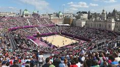 """Crowds watch beach volleyball at Horse Guards Parade in London (Pic: BBC) """"Frivolity and the heart of power"""": Is beach volleyball just near Whitehall taking the UK by storm? http://www.economist.com/blogs/blighty/2012/07/olympic-beach-volleyball"""