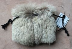 Vintage white wolf fur pouch by Lupa. Available at http://www.ebay.com/itm/VIntage-white-wolf-fur-drawstring-pouch-/141608145767