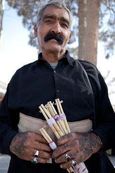Kurdish flute seller, with tattoos. Iran. by Matteo Vegetti