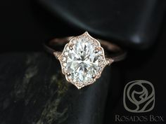 Mae 9x7mm 14kt Rose Gold Oval FB Moissanite and Diamond Halo WITHOUT Milgrain Engagement Ring (Other metals and stone options available) by RosadosBox on Etsy https://www.etsy.com/listing/257762686/mae-9x7mm-14kt-rose-gold-oval-fb