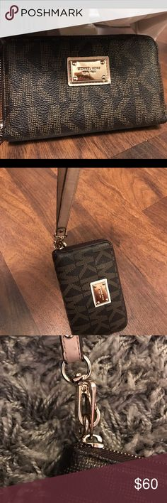MICHAEL KORS WRISTLET Brown wristlet covered in tan MK pattern. Was used a decent amount but still in good condition and very usable! Looks great with outfits (can also fit iPhone 6+7 //// not 7+) Minor wear problem with the wristlet but no stains or anything like that ((: lmk if any questions!! Michael Kors Bags Clutches & Wristlets