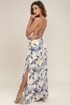 Lulus Exclusive! You'll be quite the sight in the Rather Ravishing Cream Floral Print Lace-Up Maxi Dress! Cream woven poly with a blue and yellow floral print shapes an apron neckline and princess seamed bodice supported by skinny straps. Lace-up back and elasticized waist tops a maxi skirt with twin thigh-high slits. Hidden back zipper.