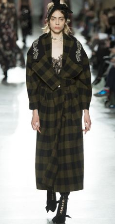 Shop now. Preen by Thornton Bregazzi CONNIE COAT. The Connie Coat is crafted with 100% Boiled Wool in green and black check. The coat features a statement collar embellished with hand-sewn crystals in a floral motif. With high side splits. Both tough and lux, the oversized shape offers indulgent comfort.