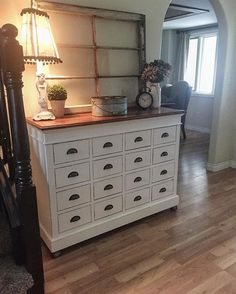 In love with this apothacary cabinet. We added the wood castors and wood top for extra farmhouse flair. #entryway#rustic #farmhouse #therustybee