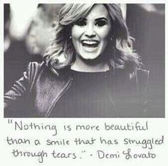 """Nothing is more beautiful than a smile that has struggled through tears."" -Demi Lovato"