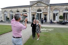 Brooke Henderson of Canada and her sister Brittany Henderson pose for a picture outside during the Ricoh Welcome Dinner in the Sculpture Gallery at...