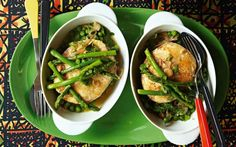 Hake steaks cooked in stock and sherry with a bowlful of young green vegetables and herbs