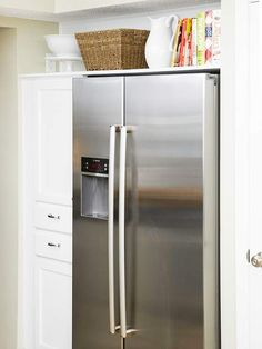 One large shelf spanning the length of the niche creates a useful space for storing cookbooks and large servingware. The result is a boost of storage real estate, as well as the look of a pricey built-in refrigerator for a lot less.