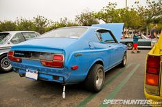 Datsun 710, with oversized mags on the rear and a jacked up 70s stance