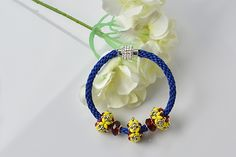 Love kumihimo bracelet? If yes, you can never miss today's Pandahall tutorial on how to make blue nylon threads kumihimo bracelet with European beads decor!