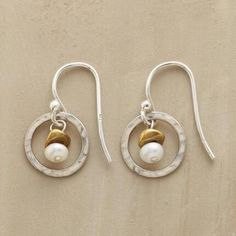 "EVERYWHERE EARRINGS - Casual or dressy, these earrings shine with hammered sterling circles in which a brass-topped pearl sways sweetly. Sterling silver wires. Exclusive. 3/4""L."
