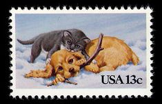 An adorable pup in the Cat and Dog in the Snow 1982 Christmas issue. This 13-cent stamp was issued for use on postcards.