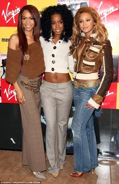 Still connected: Destiny's Child alum Beyonce (right), Kelly Rowland (middle) 2015